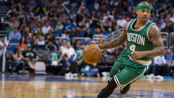 Boston Celtics guard Isaiah Thomas (4) dribbles down court against the Orlando Magic during the first half of an NBA basketball game in Orlando, Fla., Sunday, March 8, 2015.