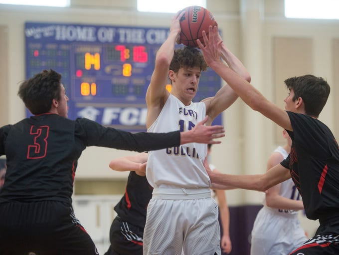 Fort Collins forward Benny Khouri is surrounded by