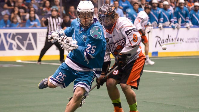 Rochester's Brad Self moves in to snatch up a loose ball from under Buffalo's Mark Steenhuis in the first half of an NLL playoff game on May 8, 2015.