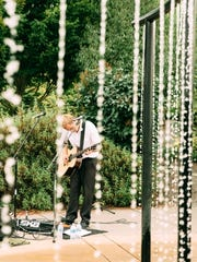 Live music is part of an artist reception for Art in the Garden at Oregon Garden.