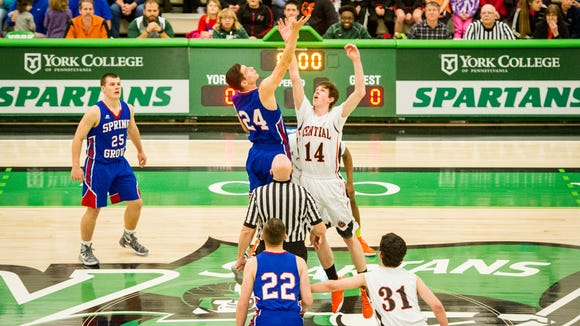 Spring Grove's Darin Gordon (24) and Central York's Tommy O'Neill (14) tip off at the start of the YAIAA boys' basketball championship game at York College. Spring Grove won, 42-36.