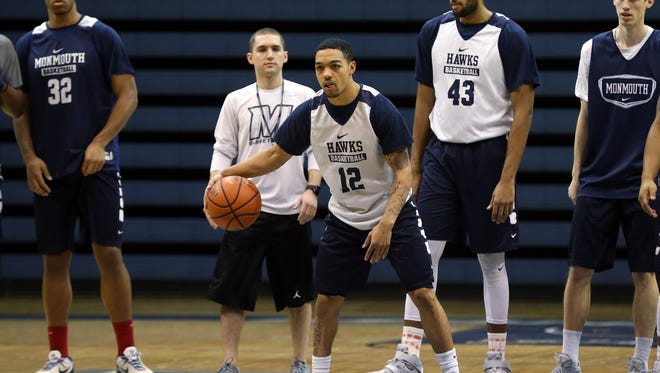 Monmouth men's basketball player Justin Robinson works out with his Hawks teammates during practice, Wednesday, March 2, 2016, in West Long Branch.