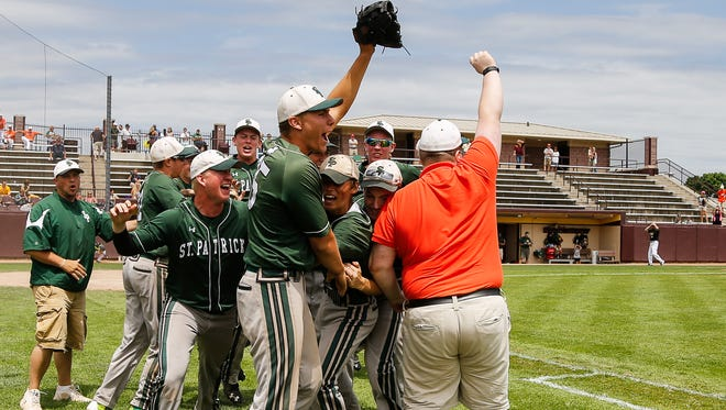 Members of the Portland St. Patrick Shamrocks celebrate their Div. 4 quarterfinal win against Muskegon Catholic Central June 14, 2016,  at Theunissen Stadium in Mt. Pleasant.