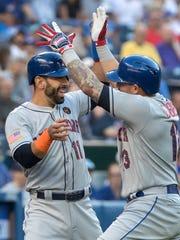 New York Mets' Asdrubal Cabrera, right, celebrates