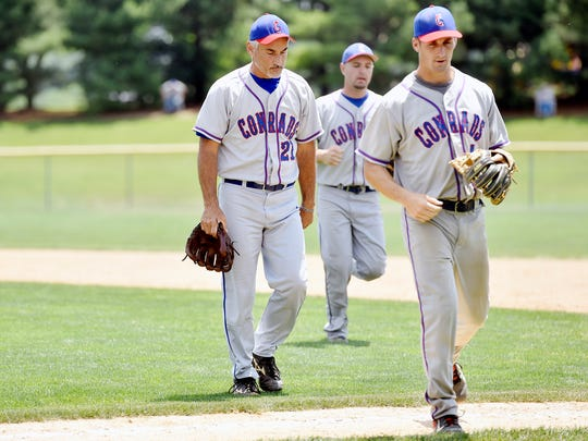 Conrads pitcher Todd Shoff, left, leaves the field at the conclusion of the bottom of the third inning of a Susquehanna League baseball game Saturday, June 25, 2016, at McWilliams Field in York Township. Shoff, a 55-year-old pitcher, is often making throws against batters half his age.