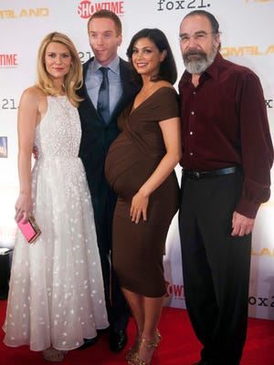 Claire Danes, Damian Lewis, Morena Baccarin, and Mandy Patinkin arrive at the private premiere screening for Season 3 of 'Homeland' at Corcoran Gallery of Art on Monday in Washington.