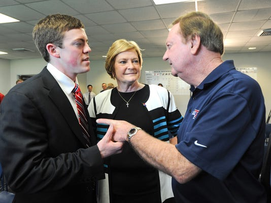 FILE - In this April 2, 2014 file photo, Tyler Summitt, left, his mother, Hall-of-Fame Tennessee Lady Vols coach Pat Summitt, and former Louisiana Tech coach Leon Barmore share a moment after a press conference to announce Tyler Summitt as the new women's basketball coach at the college, in Ruston, La. Tyler Summitt has resigned as Louisiana Tech women's basketball coach and acknowledged having an inappropriate relationship, Thursday, April 7, 2016. (AP Photo/The Shreveport Times, Douglas Collier, File) MAGS OUT; MANDATORY CREDIT SHREVEPORTTIMES.COM;  NO SALES