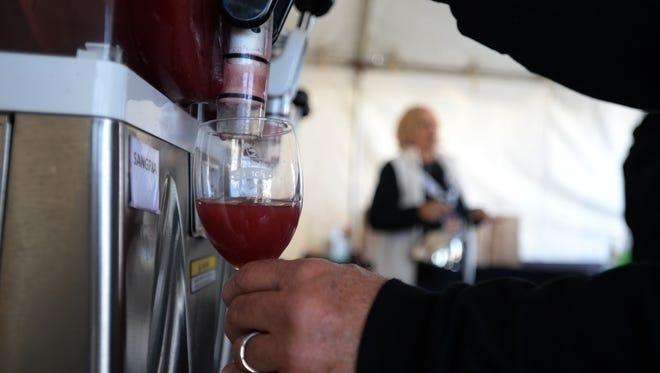 Jinx Proch pours a wine slushie at the University Wine Company tent.