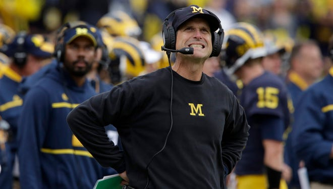 Michigan head coach Jim Harbaugh grimaces as he looks up at the scoreboard during 1st quarter action between  Michigan and Oregon State on Saturday, Sept. 12, 2015 in Ann Arbor.