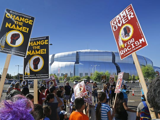 """Protesters who claim """"Redskins"""" is a slur and want"""