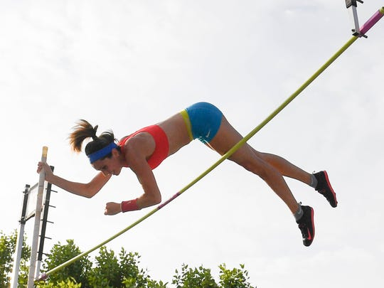 Melissa Gergel clears the bar as she competes in the 11th annual Jammin' & Jumpin' Street Vault event at the Henderson riverfront Tuesday. The former NCAA champion took the women's prize at the event, July 4, 2017.