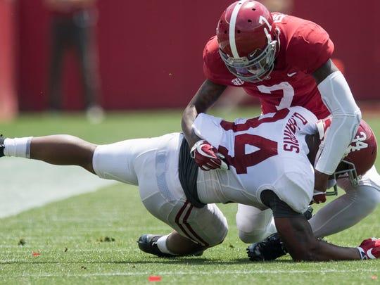 Alabama defensive back Trevon Diggs (7) stops Alabama