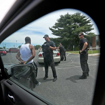 Dover police conduct a traffic stop.