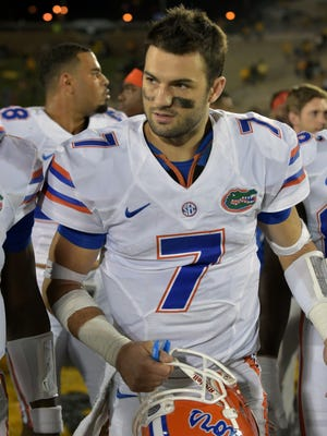Florida Gators quarterback Will Grier (7) leaves the field after the win over the Missouri Tigers at Faurot Field.