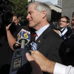 Jerry Kilgore, a former Virginia attorney general, center, is encircled by the media as he makes his way Aug. 12, 2014, to the federal courthouse in Richmond, Va., for his testimony in the corruption trial of former Gov. Bob McDonnell and his wife, Maureen.