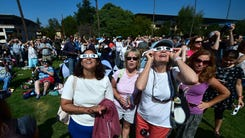 People use solar eclipse glasses to view the solar eclipse from Beckman Lawn at Caltech in Pasadena, California on August 21, 2017. Emotional sky-gazers on the US West Coast cheered and applauded Monday as the Sun briefly vanished behind the Moon -- a rare total solar eclipse that will stretch across North America for the first time in nearly a century. / AFP PHOTO / FREDERIC J. BROWNFREDERIC J. BROWN/AFP/Getty Images ORIG FILE ID: AFP_RQ5ZZ