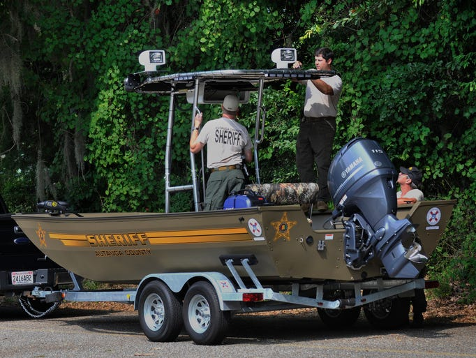 Autauga County Sheriff's Department prepare to take to the Alabama River on Saturday, July 5, 2014, as they check out their new boat made possible through a grant from the Department of Homeland Security.