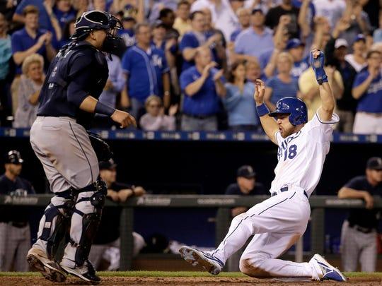 The Kansas City Royals' Ben Zobrist slides home past