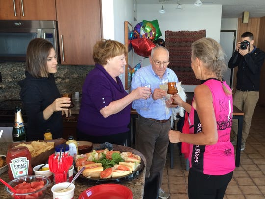 Solé Salvo (left), Susie Schmitt, Giovanni Salvo and Lynn Salvo toast the end of the ride with champagne.