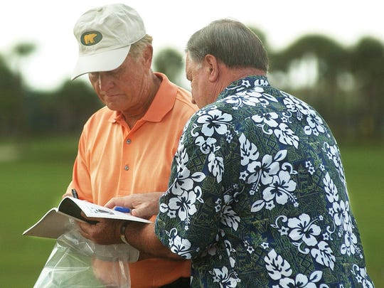 2-12-2004; 1c Jack Nicklaus pauses to sign some autographs for Richard Bailey, from Plano, Texas, including a 1972 Sports Illustrated that featured Nicklaus on the cover, before he went on to play in the ACE Group Classic Pro-Am at TwinEagles on Wednesday, February 11. TODD STUBING/The News-Press