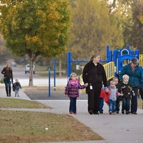 Talahi Community School students walk to school Wednesday as part of National Walk to School Day activities at the school.