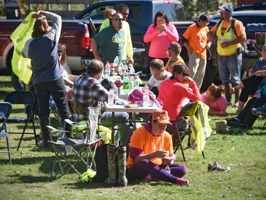Searchers take a lunch break while searching for Shannah Boiteau at an area just south of St. Cloud on Saturday, Oct. 1. The Wisconsin woman was reported missing in June.