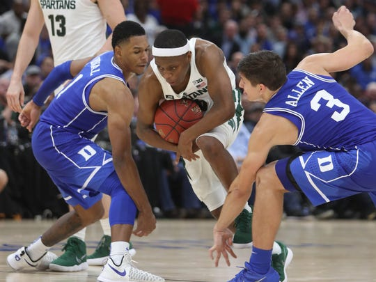 Michigan State's Cassius Winston drives against Duke's Trevon Duval, left, and Grayson Allen during the second half of MSU's 88-81 loss on Tuesday, Nov. 14, 2017, in Chicago.