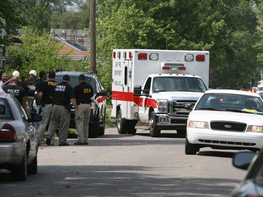 An ambulance takes away one of the suspects in the shooting death of veteran Gary, Ind., police officer Jeff Westerfield on July 6, 2014.