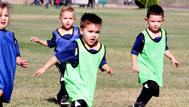 Dominic Gonzales, 4, has taken a shine to the Deming Youth Soccer League. It's tournament time among the young athletes, but Dominic has a few distractions. He likes to run and kick the soccer ball, but he also has a fascination with dandelions. During a recent Saturday match Dominic found himself in a furious exchange at midfield. His eyes caught a dandelion near the center circle at midfield and the hotly-contested match became secondary. The league does not keep score for the Under 4 Division and Dominic and all of the young athletes were winners.