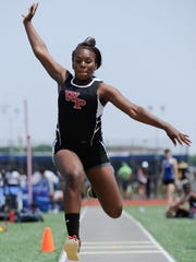 William Penn's Tasia Dennis competes in the triple jump at the state track meet at Dover High School.