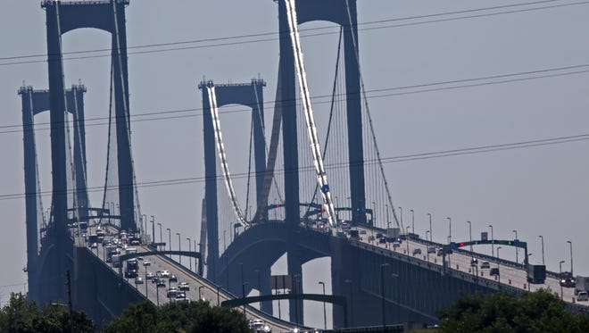 Large trucks travel into Delaware after crossing the Delaware Memorial Bridge. Trucks will be prohibited from driving on I-95 through Philadelphia and many are likely to bypass the city using I-295 across the Delaware Memorial Bridge.