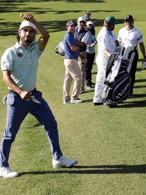 Abraham Ancer walks off the No. 9 green after shooting 68-67 to lead the Masters Tournament on Friday