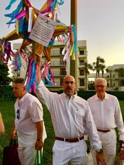 Roving raffler Darrell Horn tempts guests with festive