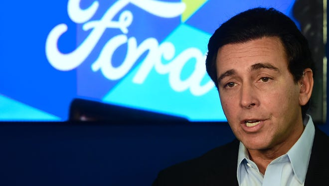 Mark Fields, President and CEO of Ford Motor Company speaks at the opening of the Los Angeles auto show.