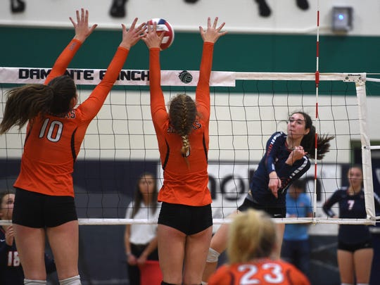 Douglas' Sierra Sullivan (1) and Hailey Hughes (10) block the shot of Bishop Gorman's Sydney Lobato (5) during the semifinals of the NIAA 4A volleyball tournament at Damonte Ranch  on Friday.
