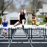 Choteau's Hannah King competes in the 100 hurdles.