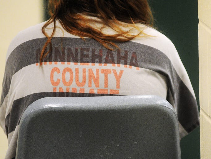 A Minnehaha County Jail inmate in the booking area on Friday, July 25, 2014, at the Minnehaha County Jail in Sioux Falls, S.D.