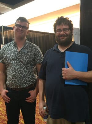 Blake Ross, left, a health access counselor at Western Carolina Medical Society, helped Michael Wechselblatt enroll in a health insurance plan Saturday at the U.S. Cellular Center in downtown Asheville.