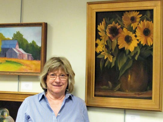 Green Brook artist Terry Gauld poses alongside her