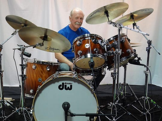 Butch Trucks smiles from his seat behind the drums.