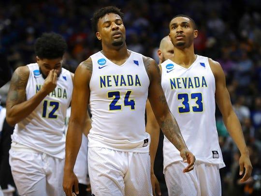 Nevada's Elijah Foster, Jordan Caroline, and Josh Hall,
