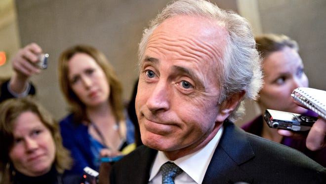 In this Oct. 11, 2013 file photo, Sen. Bob Corker, R-Tenn., speaks to reporters on Capitol Hill in Washington.