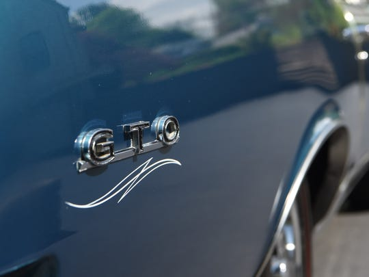 A closeup of the 1967 Pontiac GTO, one of the cars Kenny Pascoe has collected.