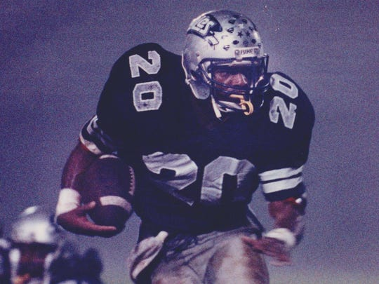 Former Middletown South running back Stephen Pitts carries the ball during a game on Oct. 13, 1990, his senior season.