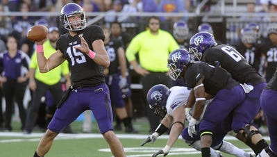 Luke Papilion passes for some of the many yards he accrued against Winona State.
