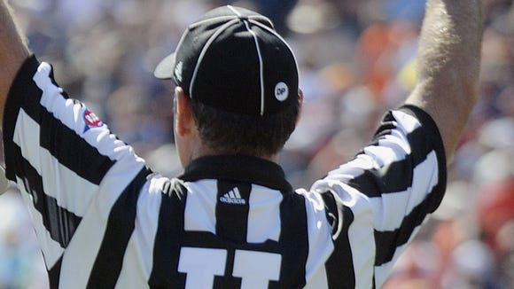 The SEC will be experimenting with an eight-man officiating crew this season.