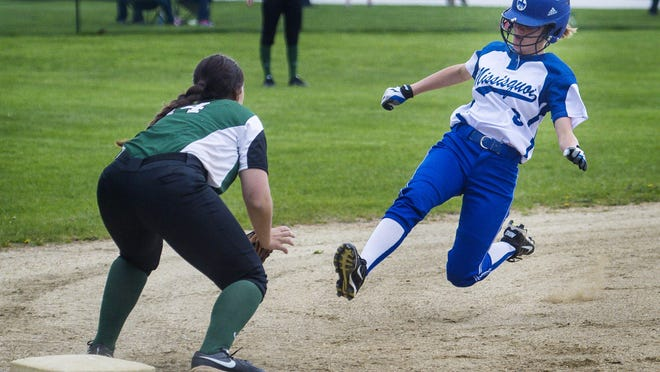 Missisquoi's Savannah Dufresne, right, slides into third as Rice's Mikayla Butkus awaits in South Burlington on Thursday.