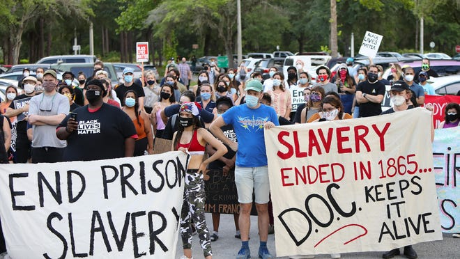 A coalition of groups gather to protest at the Alachua County Jail on June 19.