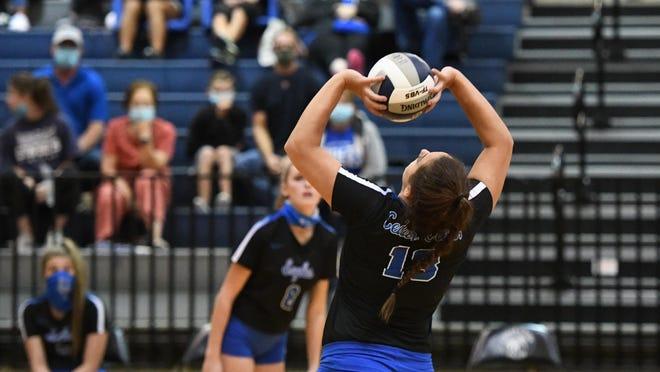 Cedar Creek's Justice Gabaldon sets the ball for a teammate.