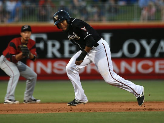 El Paso's Manuel Margot races to reach third base ahead of the ball as Sacramento shortstop Hak-Ju Lee prepares to field the grounder Thursday at Southwest University Park. Lee was able to put out a runner at first on the play.